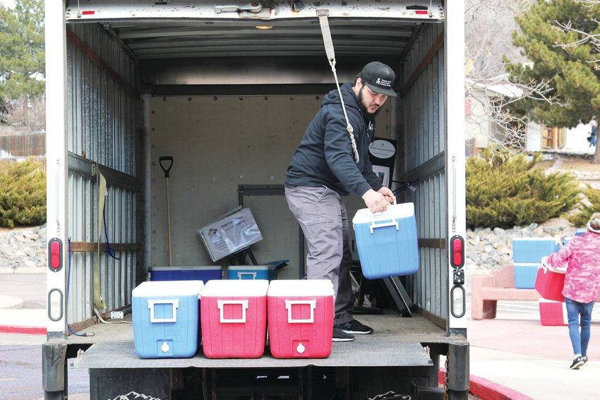 Douglas County School District staff unload coolers full of lunches on March 23, the first day the district offered free lunches to children while schools are closed amid the COVID-19 pandemic.