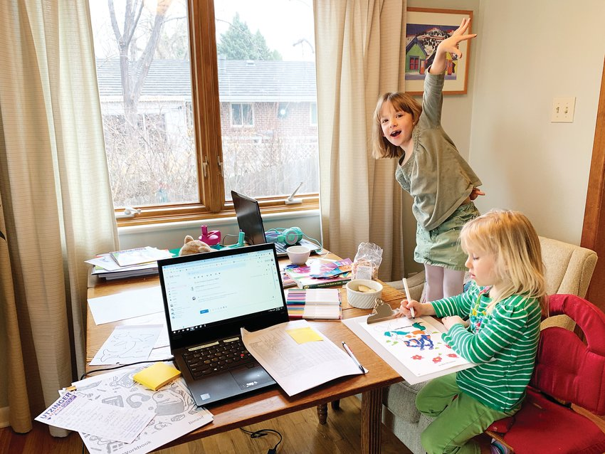 Herrin's daughters Mae, 6, who attends Stober Elementary, and Ellis, 4, who is in preschool at St. Joan of Arc, work from home during the remote learning plan.