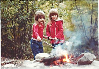 My sister Julie, left, and me roasting marshmallows on a camping trip at Rocky Mountain National Forest circa mid-1980s.