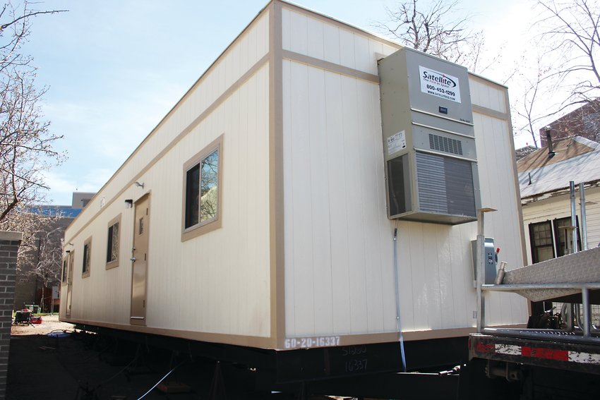 Swedish Medical Center has installed a trailer outside its emergency room in case the emergency room gets too packed. The hospital is also dedicating units for COVID-19 patients.