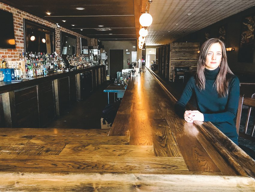 Erika Zierke sits inside the Englewood Grand bar. The bar elected to close before official orders from the state, Zierke said, as a way to flatten the curve of the COVID-19 pandemic and be cautious. The bar doesn't plan to offer to-go orders for the time being.