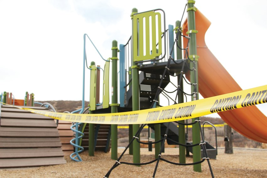 Playgrounds at Philip S. Miller Park in Castle Rock are taped off, although the park remains open to people if they properly socially distance.