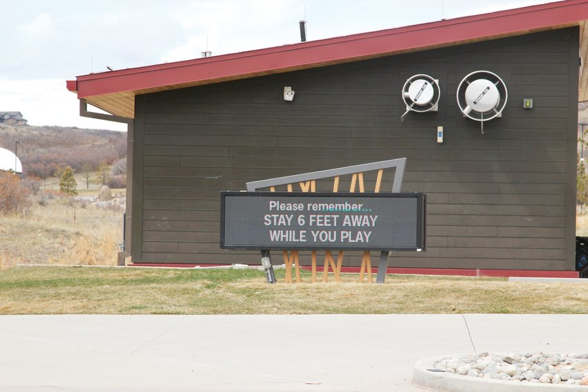 Signage at Philip S. Miller Park in Castle Rock reminded users that they must socially distance while there. The town has closed indoor recreation facilities while leaving other outdoor facilities open.