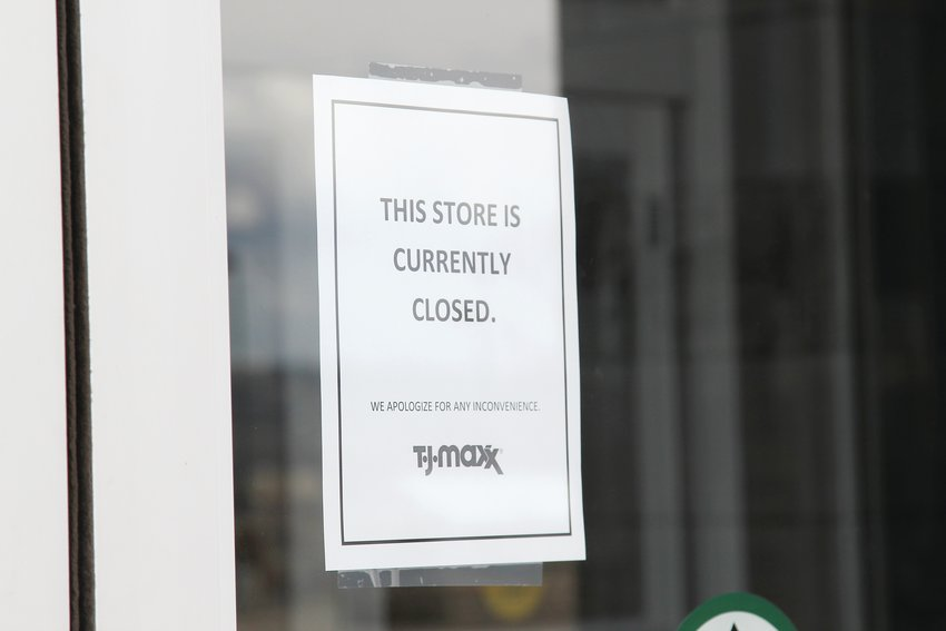Signs about temporary closures dot the entrances to many businesses in Castle Rock as the state remains under a shelter-at-home order.