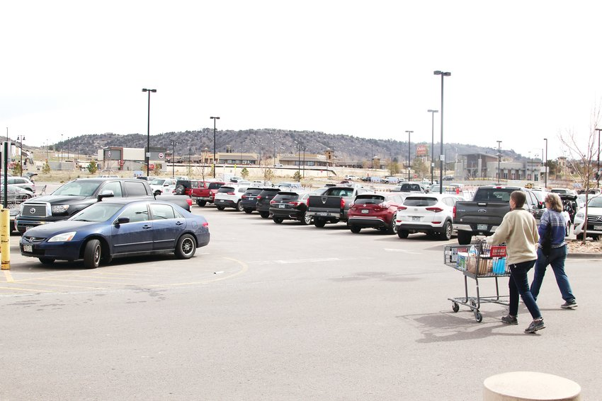 While some stores have closed entirely during the pandemic and their parking lots sit empty during the governor's stay-at-home order, others businesses remain bustling hotspots, like grocery stores and home improvement stores. Here, shoppers leave the King Soopers near the Promenade at Castle Rock on March 30.