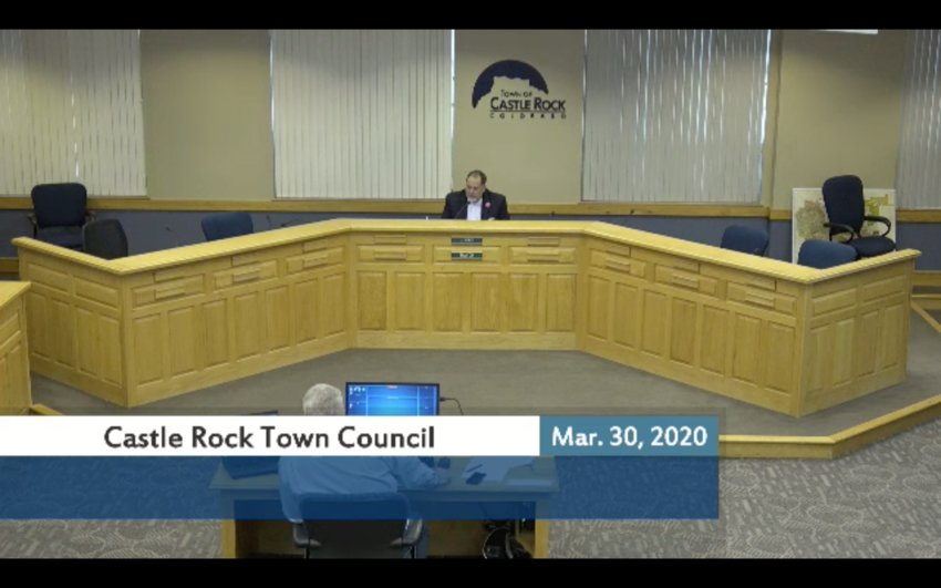 Mayor Jason Gray sits at town hall during an emergency virtual council meeting to discuss assistance programs for small businesses and residents.