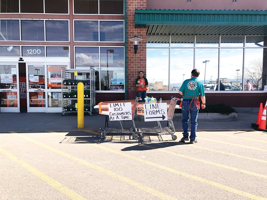 Home Depot employees manage the line outside of the store in Highlands Ranch in late March. Employees said people were mostly buying home improvement gear, cleaning products and supplies for home repairs in case of an emergency.