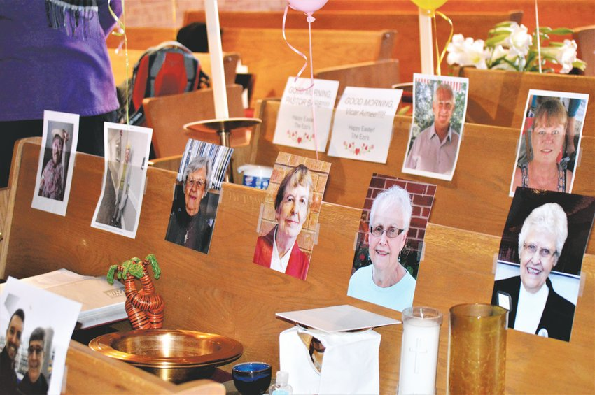 The pews at Advent Lutheran Church would normally be full of people for Easter Sunday services. This year the pews were largely empty due to COVID-19 quarantines, but members placed photos of themselves to greet the pastor.
