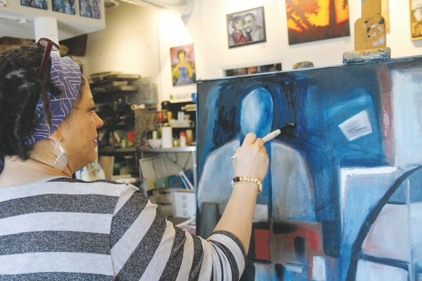 Tabetha Landt, owner of the Landt Creative Space art studio in the 40 West Arts District works on an untitled piece. Landt teaches art classes and has moved all of her classes online.