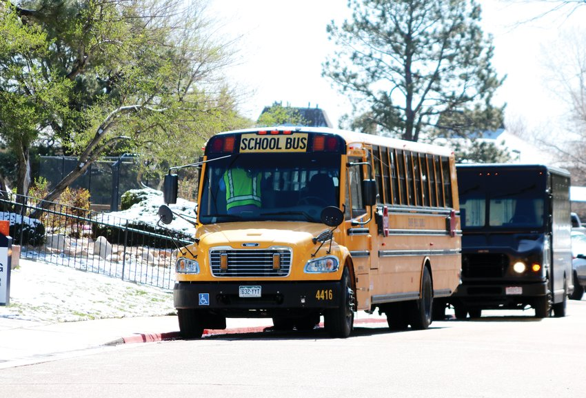 A Denver Public Schools bus parks outside of an apartment complex in Denver's Hilltop neighborhood to get ready to provide breakfast and lunch to students as part of the district's food distribution program.