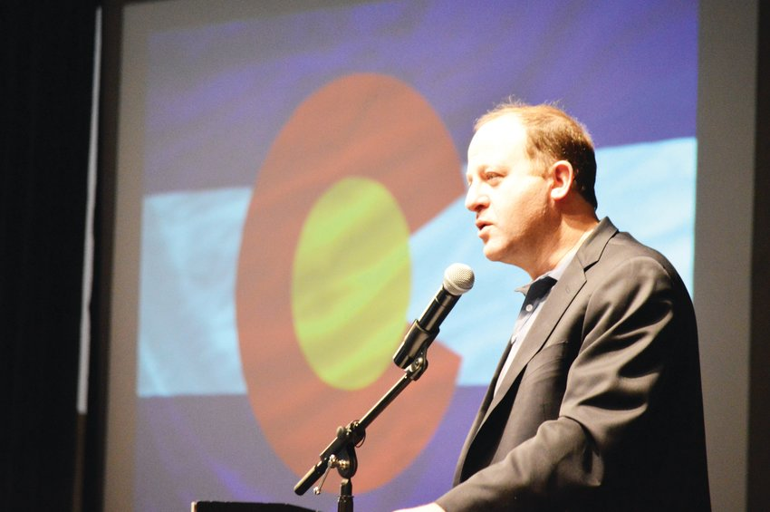 Colorado Gov. Jared Polis, shown here in January, gave an April 15 presentation that said a ban on large gatherings will likely continue for months.