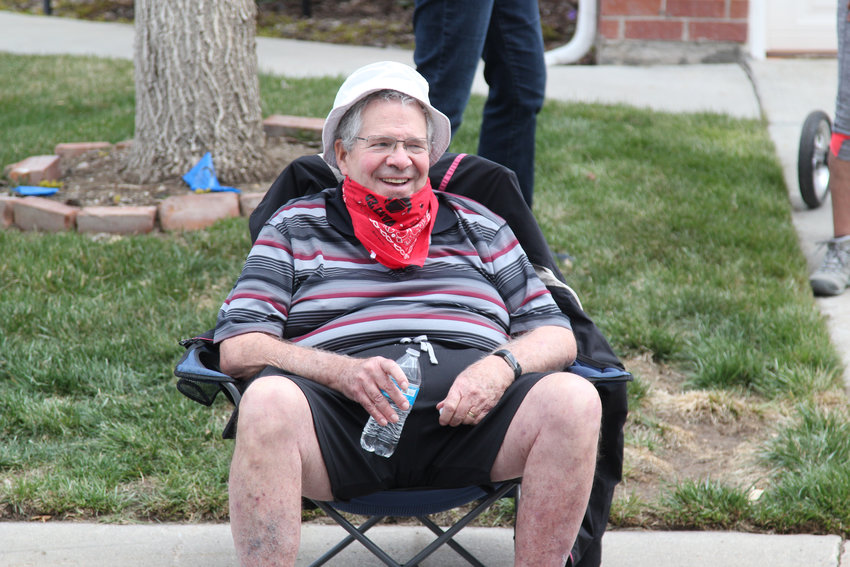 Neighbor John Robbins set up a lawn chair to watch the parade for Evelyn Berkey on her 100th birthday.