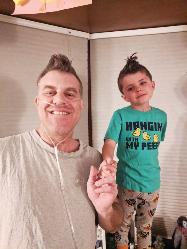 Brian Seamon and his son, Avery, after Brian's return from the ICU, where he was treated for COVID-19.