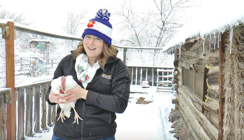 "Megan Murphy holds a chicken during a ""Meet the Chickens"" event as part of the Jefferson County Library District's online offerings."