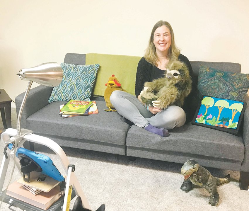 Karen Walker, a kids and family librarian at the Jefferson County Library District, inside the virtual studio she has created inside her home for presenting virtual programs, such as storytime.