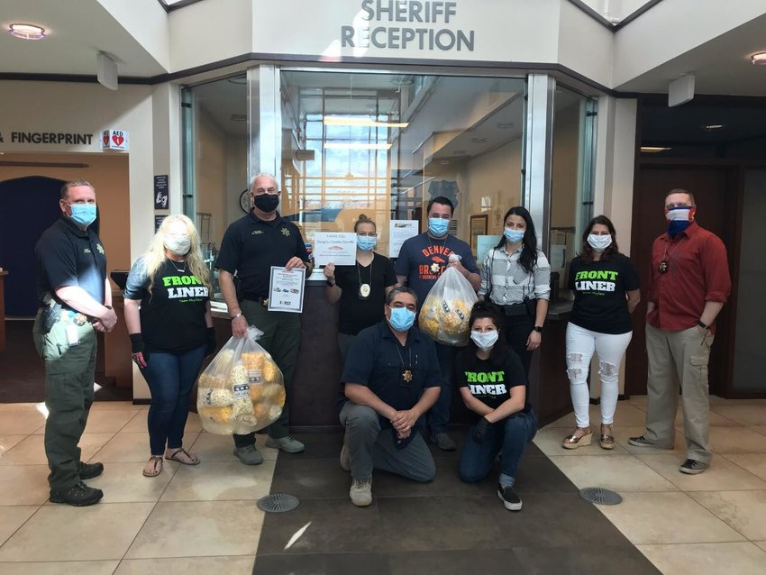 Cornzapoppin of Highlands Ranch donated 29 bags of popcorn to the Douglas County Sheriff's Office's Highlands Ranch substation on May 1, and Servpro of Englewood/East Littleton donated another 40 bags.
