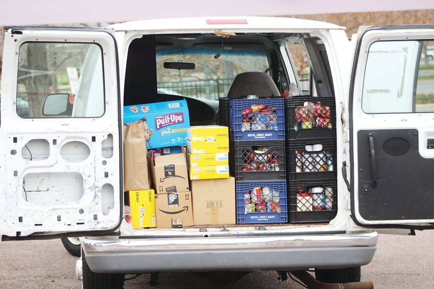 A van packed with food donations. Those who wish to pick up free groceries from the Action Center can call 720-215-4850.