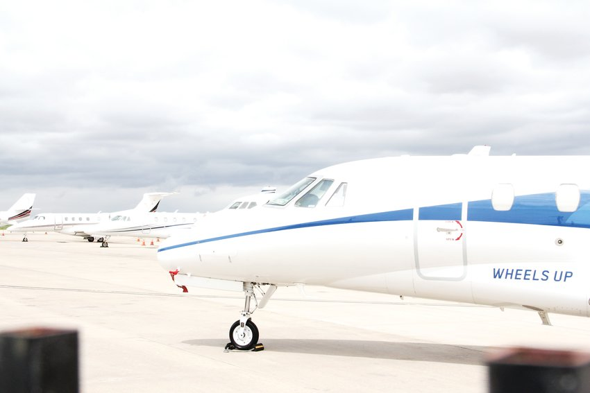 Planes stand at Centennial Airport in May 2019.