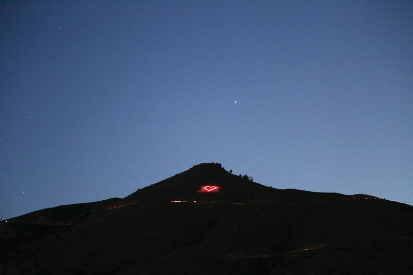 "Where the School of Mines ""M"" is usually seen, a heart made of red lights shines each night from Lookout Mountain in Golden. The heart illuminates in support of medical professionals during the COVID19 pandemic."