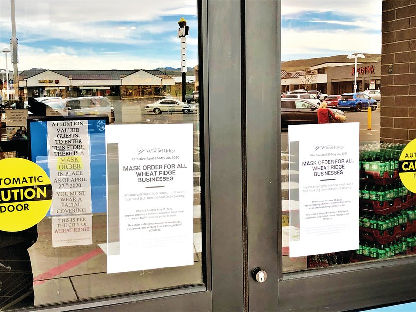 Signs have been posted to the front doors of the King Soopers at Applewood Village in Wheat Ridge.