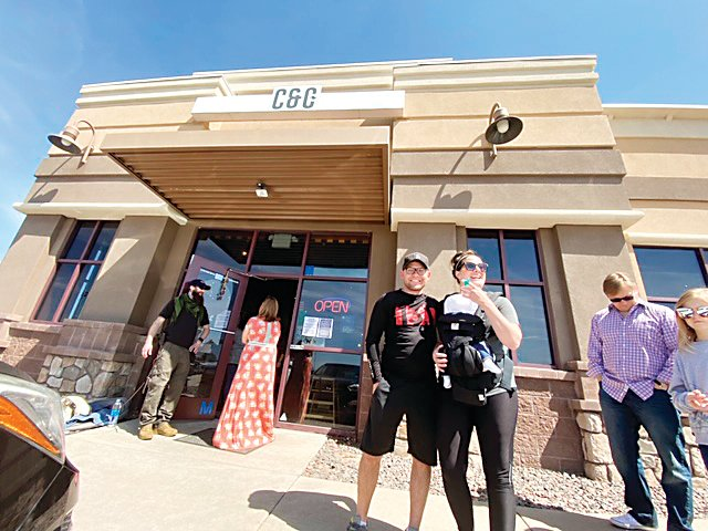A couple celebrate their first mother's day at C&C Coffee and Kitchen in Castle Rock May 10.