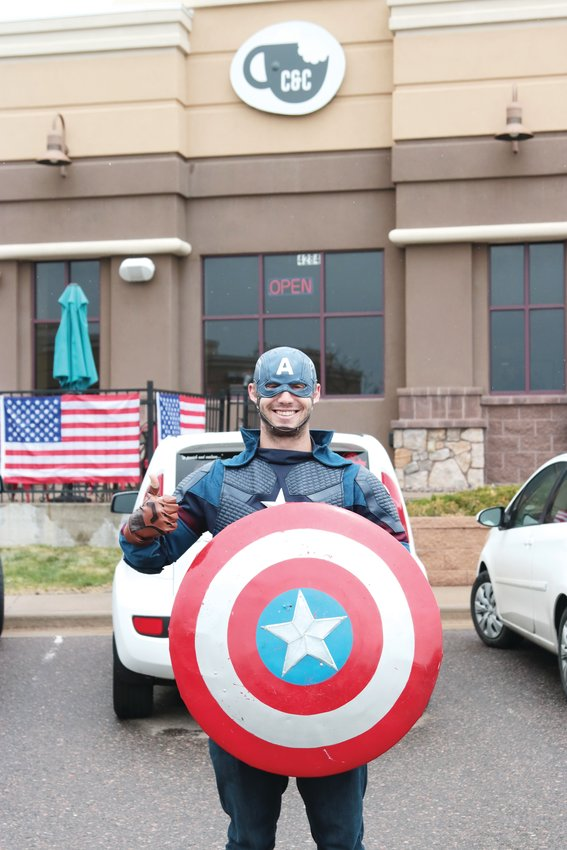 Castle Rock resident Tyler Magana dressed in a Captain America costume in support of C & C restaurant in Castle Rock May 11 and promoted the restaurant.