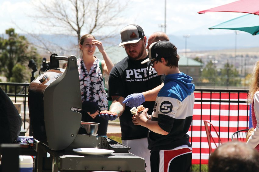 Supporters of C&C Coffee and Kitchen pulled up a grill to the Castle Rock location on May 12 and served up free food.