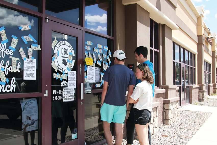 A steady stream of people stopped by C&C Coffee and Kitchen on May 12. Some hoped to order food and found the restaurant closed. Others taped cash donations to the storefront. A few came simply to see the spectacle.