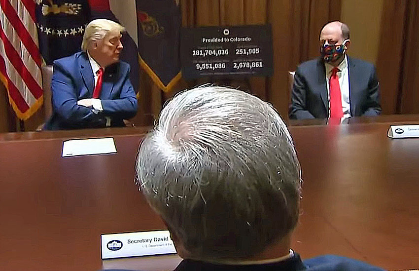 President Donald Trump and Colorado Gov. Jared Polis discuss the COVID-19 situation at the White House on May 13, 2020. In the foreground, back to camera, is U.S. Interior Secretary David Bernhardt, a Coloradan. Also at the meeting, off camera, was U.S. Sen. Cory Gardner, R-Colorado.