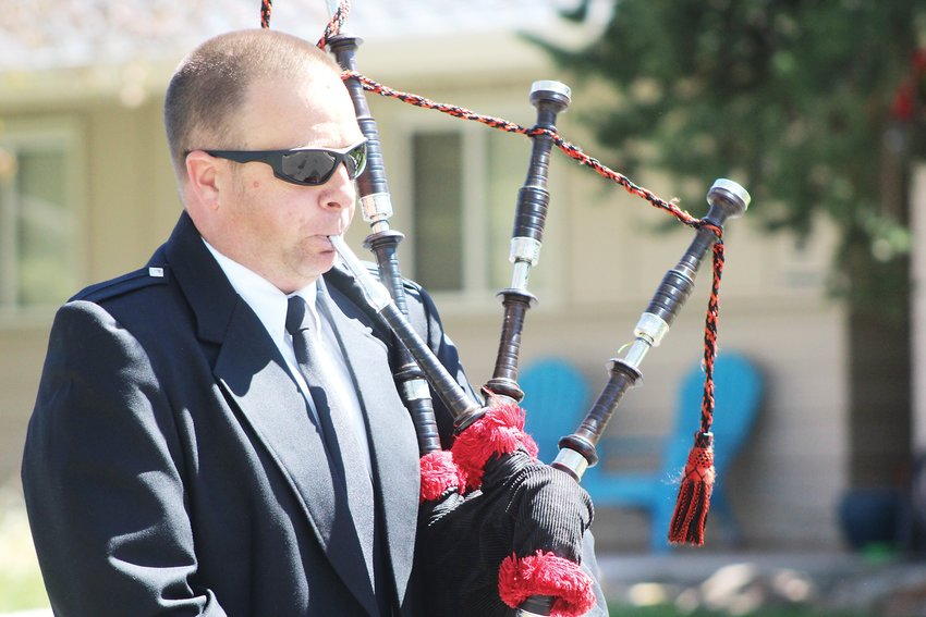 Dan Fahrney, a firefighter for West Metro Fire, plays the bagpipes. The fire department participated in the parade along with graduates, families and Applewood Grove residents.