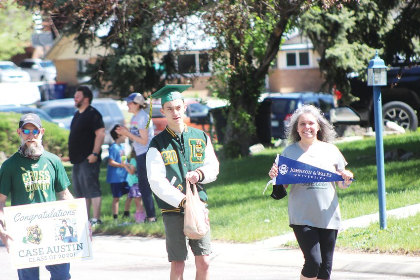 Case Austin of Bear Creek High School walks in the parade. Austin plans to attend Johnson & Wales University this fall.