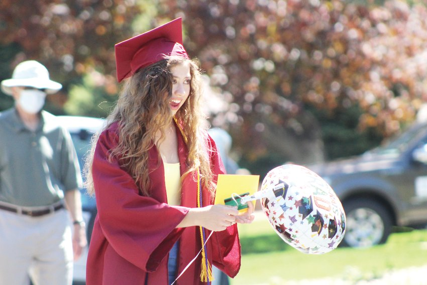 Kaylin Bates, a Golden High School graduate, smiles. The Applewood Grove neighborhood is home to 2020 graduates of Wheat Ridge, Golden, Green Mountain, Lakewood and Bear Creek high schools.