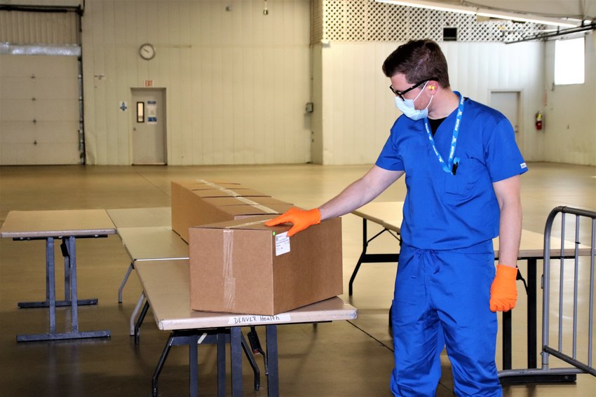 Site manager Bartosz Koszowski points to six boxes of treated, decontaminated N95 masks from a Denver area hospital that are waiting to be picked up and sent back to the hospital.