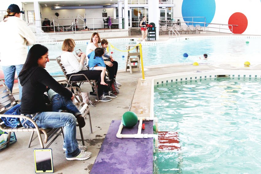 If and when pools do reopen this summer, it will likely be with new social distancing measures. Closures would mean the loss of community services like exercise classes and swim lesson, pool operators say. Here, families wait for swim lessons at the Highlands Ranch Recreation Center at Eastridge in March 2020.
