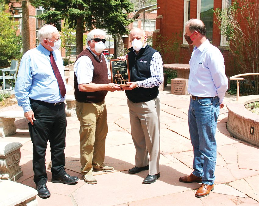 Golden Rotary Club member Tom Hughes presents Mount Evans Home Health Care & Hospice President and CEO Charley Shimanski with the club's Ethics in Business award while Golden Rotary Club member Paul Haseman, far left, and Allen Gregory, the club's president, look on.