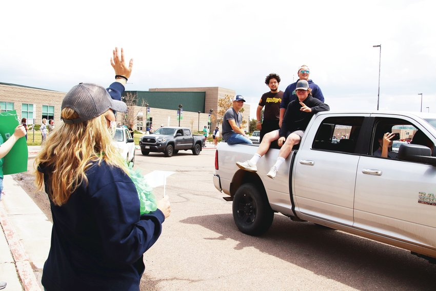 Truck beds were a popular conveyance for students at the ThunderRidge High School graduates' parade.