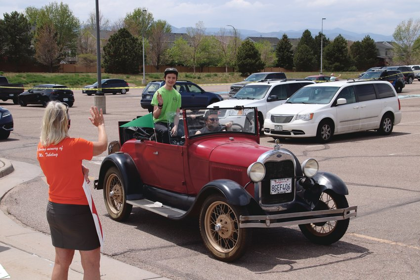 Some ThunderRidge High School students arrived for their parade of seniors in antique cars.