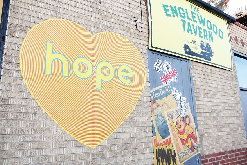 "A large heart bearing the word ""hope"" sits on the wall of the building that houses The Englewood Tavern on South Broadway May 20. Artist Koko Bayer has placed the hearts throughout the Denver metro area — including a 12-foot-by-12-foot version of it on the Arvada Center building, according to Collin Parson, the center's director of galleries and curator. ""It's things like those that give me hope and energy to keep getting art out there,"" Parson said."