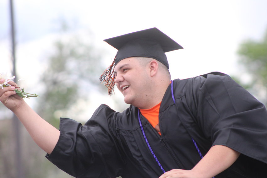 Michael Harrison catches a flower. 2020 Jeffco Public Schools graduates will be presented with a resilience cord, according to a letter from Jeffco Public Schools Superintendent Jason Glass.