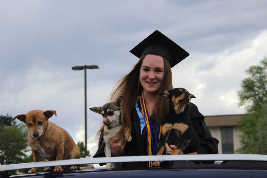 Sage Farrow pops up out of her family's car. Lakewood High School hosted a drive by parade at its campus for the school's 2020 graduates on May 21.