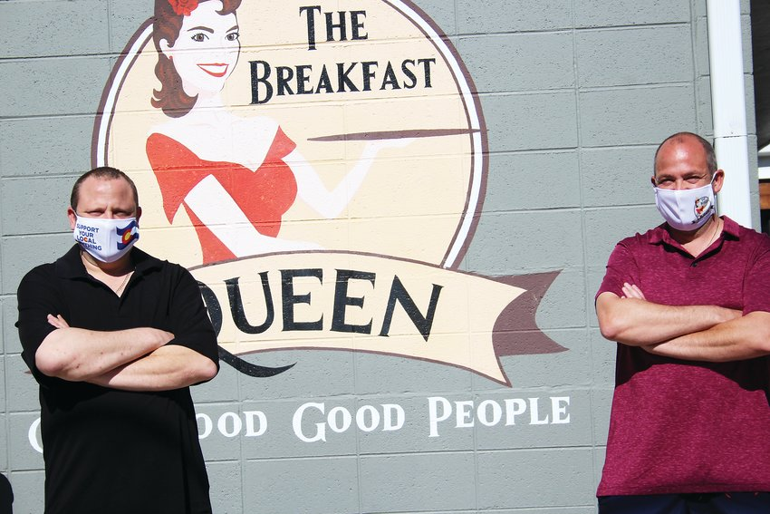 George Vasilas, left, and Kosta Vasilas stand in the back of the Breakfast Queen's building. Kosta said the restaurant is excited about the possibility to offer dine-in-services and said Breakfast Queen needs to expand its outdoor seating.