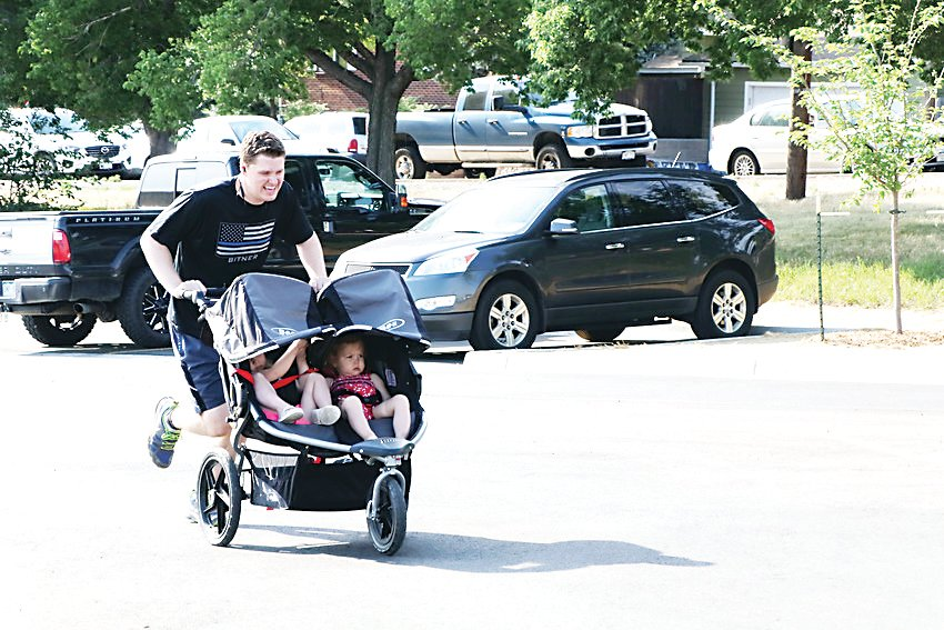 Garrick Storgaard pushes his double stroller across the finish line as he is one of the runners and walkers who took part in the 2018 Jeremy Bitner Fallen Memorial 5K/10K Run and 5K Walk. The event is held in memory of Detective Jeremy Bitner who was killed in the line of duty.