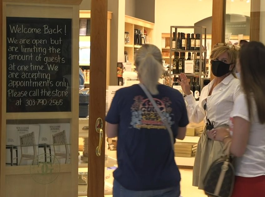 An employee welcomes shoppers into the Williams-Sonoma store at Park Meadows mall in Lone Tree on May 24, 2020.