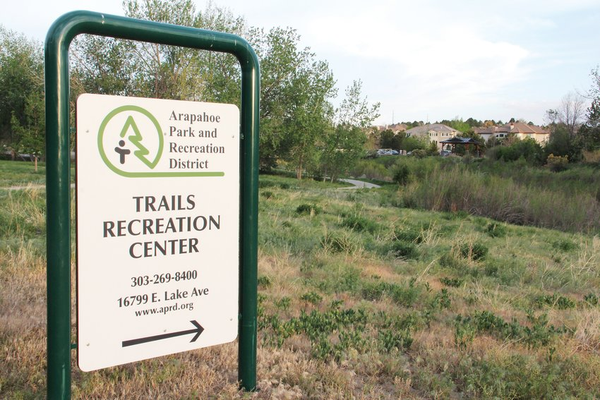 An Arapahoe Park and Recreation District sign along a path that leads to Trails Recreation Center in Centennial, May 19. The district oversees parks, trails and that rec center in the east Centennial area.
