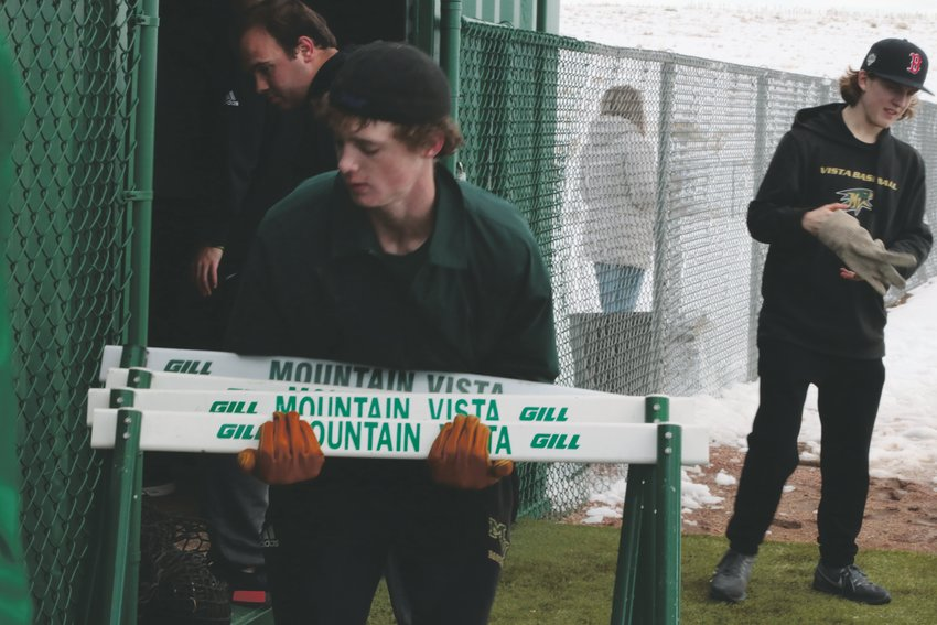 Patrick Boland, 16, helps clean up the Mountain Vista baseball field during a practice in February.