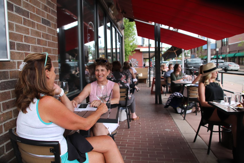 People dine at Vines Wine Bar in Parker May 29. Restaurants are once again allowed to serve customers on-site with social distancing guidelines in place. The Town of Parker passed an emergency ordinance allowing restaurants to expand outdoor seating areas to increase capacity.