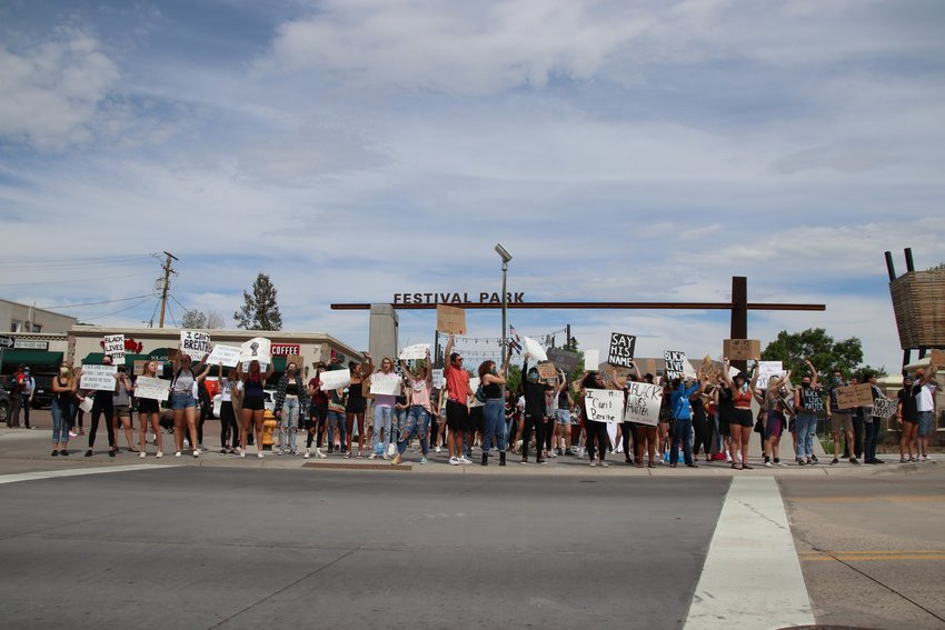 Protesters gather in Castle Rock on June 2, 2020, to call attention to racial injustice in the wake of the killing of George Floyd.