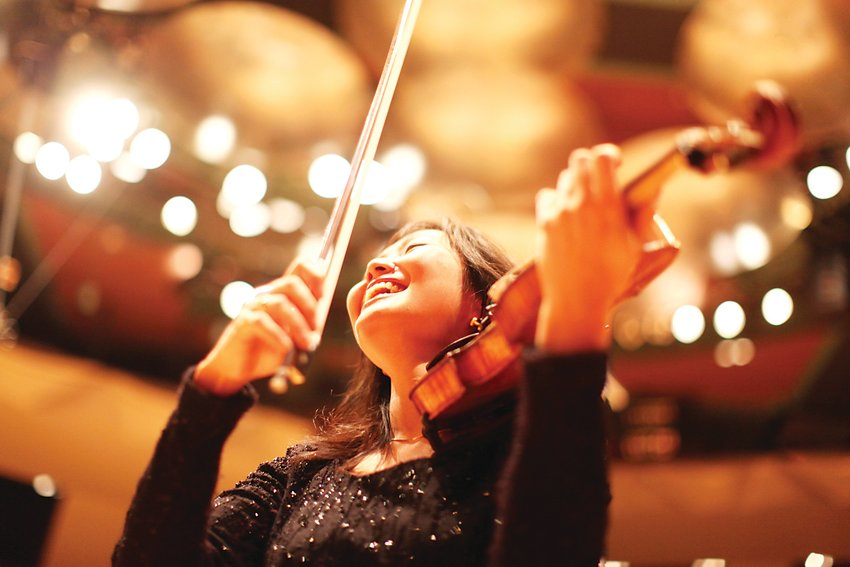 Yumi Hwang-Williams, violinist and concertmaster with the Colorado Symphony, is celebrating her 20th year with the orchestra this season. The orchestra is looking forward to performing live again, once it is safe to do so following the COVID-19 pandemic, Hwang-Williams said.