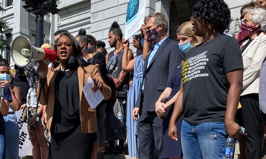 Colorado state Rep. Leslie Herod, D-Denver, surrounded by family members of men who died at the hands of law enforcement, discusses her proposed bill on police accountability to a crowd assembled at the Capitol to protest the death of Minneapolis man George Floyd.