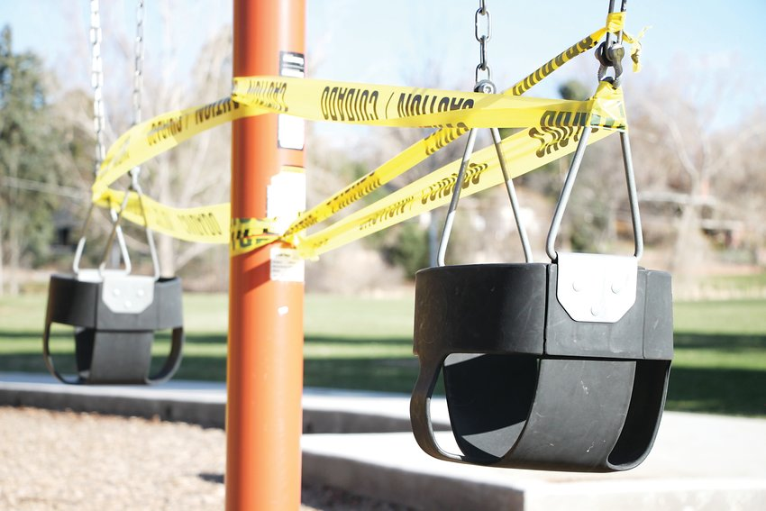 Caution tape wraps swings at Sterne Park in Littleton.